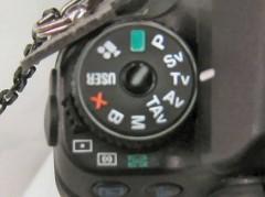 ペンタックス K-7: モードダイヤルと測光モード切替レバー